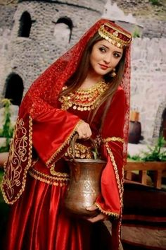 Iranian girl in traditional Azari costume.                                                                                                                                                                                 More