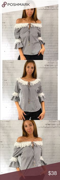 Girly Gingham Blouse Black & white girly gingham blouse. Wear on or off the shoulder. Lace detail along neckline and sleeves. Tie front and side zipper closure. Pair with black or white pants for a classic summer look. Made of a poly blend.                                      Small  Bust 38 Length 23 Shoulder to shoulder 20  Medium  Bust 40 Length 23 Shoulder to shoulder 21  Large  Bust 42 Length 24 Shoulder to shoulder 23 Tops Blouses