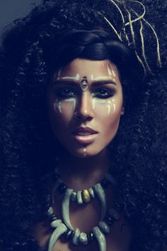 Love the Tribal Inspired makeup  jewellery