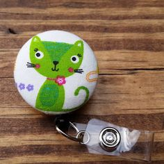 Check out this item in my Etsy shop https://www.etsy.com/listing/246849087/cat-badge-reel-green-badge-cover-id