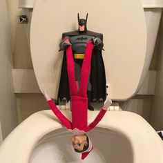 Batman holding Elf on the Shelf over the Party by WV Mom on Instagram and the best Elf on the Shelf Ideas