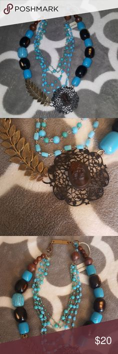 Turquoise Statement Necklace Faux turquoise necklace with wooden beads and statement piece. Jewelry Necklaces