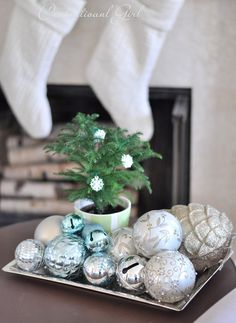 {Centsational Girl}!!! Bene'!!! Contemporary/,Modern turquoise and mint green ornament display in a natural bowl filled with a rustic pottery pinecone whitewashed in a light greenish tint and the other mixed color blown glass ornaments!!!