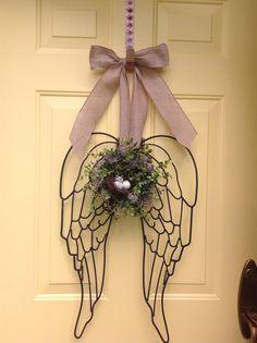 Beautiful metal angel wings door or wall arrangement