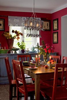 red kitchen with a great chandelier
