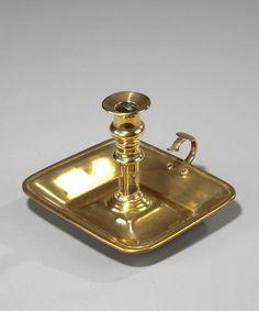 A Georgian brass chamberstick. (England)