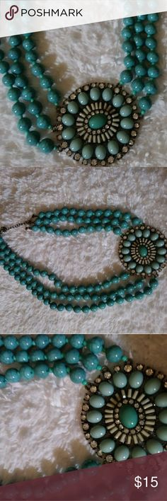 Beautiful 3 strand Turquoise statement necklace Beautiful 3 strand Turquoise statement necklace with medallion and rhinestones...NWOT Jewelry Necklaces