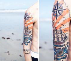 Ship at sea and anchor tattoo. Beautiful ink