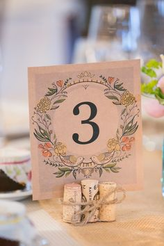 Wine Cork table number holders Barn At Gibbet Hill Wedding Read more - http://www.stylemepretty.com/massachusetts-weddings/groton-massachusetts/2014/02/27/barn-at-gibbet-hill-wedding/