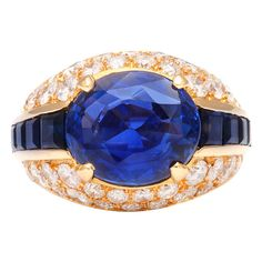 BULGARI Sapphire & Diamond Ring-- really don't like the setting but OMG what a beautiful cornflower blue center stone! Seller says 9.4 carat wt. certified UNTREATED ceylon stone.