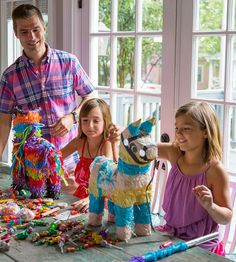 Stuffing a Pinata - Hosting a family-friendly fiesta isn't just about the food. Activities such as pinatas keep the kids happy between nibbles. Acheson and his daughters stuff their pinatas with little toys, Mexican candies, and a few special treats from a local chocolate maker.