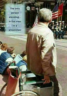 amazing...The only person standing is the man in the wheelchair~he knows the price of freedom...
