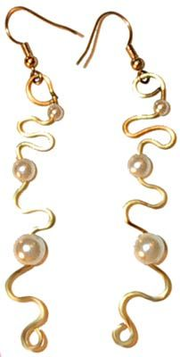Check out http://www.womanaccessory.com/ for girls earrings and cool necklaces.