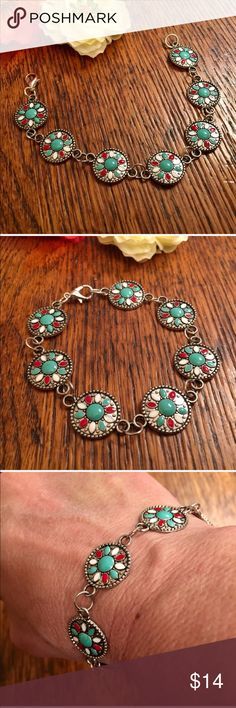 """Red, White & Turquoise Concho Bracelet Pretty and colorful concho bracelet is silver toned with a lobster claw closure. It's 7 3/4"""" in length The Painted Jezebel Designs Jewelry Bracelets"""