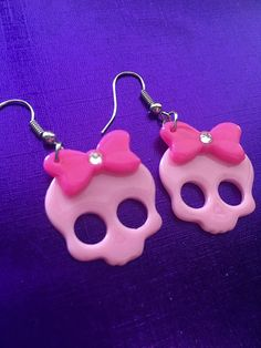 Pink and hot pink skull earrings with a hot pink bow and
