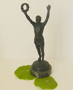 An awesome Art Deco statue.you can even see his muscles. I believe this piece to be bronze. Very heavy. No damage other than a few scratches on his back. All original.