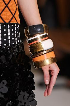 I'm on a hunt for bangles!!! These are calling my name....  Spring 2012 trend report: MARNI
