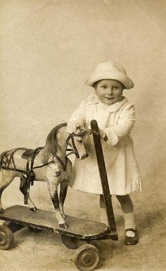 Vintage Toys Child with Toy Horse 1912 - Found image.