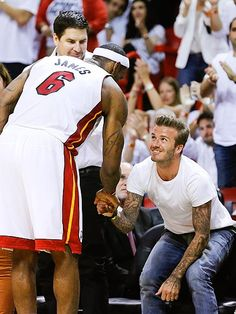 David Beckham gets his own personal meet and greet with forward LeBron James during game seven of the NBA Eastern Conference finals on Monday in Miami, where the hometown Heat defeated the Indiana Pacers, 99-76.