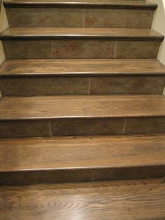 Use entryway tile on stair risers to give some continuity?    Slate Stair Risers