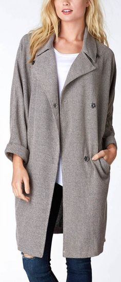 A trendy coat to throw on during the cold season. Stylish grey trench coat to make your outfit perfect!