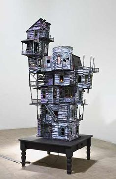 Richard Hawkins, The Last House, 2010. Altered dollhouse, lighting, and table, 89 x 36 x 36 in.