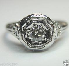 ANTIQUE ART DECO DIAMOND ENGAGEMENT RING RE - 545   {International Buyers Are Responsible For Customs & Duty Fee's}  CIRCA ~ 1930'S  NATURAL DIAMOND ~ TRANSITION ROUND BRILLIANT  SIZE ~ .23 CARAT  COLOR ~ E - F  CLARITY ~ VS 1 - VS 2   MEASUREMENT OF DIAMOND ~ 3.60 MM x 3.50 MM x 2.10 MM  METAL ~ 18K WHITE SOLID GOLD  WEIGHT ~ 2.2 GRAMS  FINGER SIZE ~ 7.25  (SIZABLE) U.S.A & CANADA (Inquire About Sizing Cost)  (O) UNITED KINGDOM, IRELAND, AUSTRALIA & NEW ZEALAND