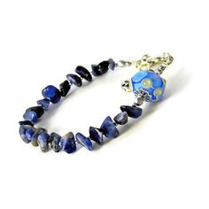 Sodalite Lampwork bracelet, Blue Boho Gemstone bracelet, Blue bohemian... ($24) ❤ liked on Polyvore featuring jewelry, bracelets, blue gemstone jewelry, blue glass jewelry, blue jewelry, glass bangles and bohemian jewelry
