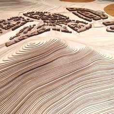 This model of a new town, Dirab, in Saudi Arabia was part of the exhibition 'Arab Contemporary' at Louisiana Museum of Modern Art in 2014. The project implement Nordic architectural traditions like the active use of daylight in the design of different dwelling types that are designed in accordance with the local building traditions. By laser cutting numerous sheets of veneer and putting them on top of one another this hilly landscape was constructed.