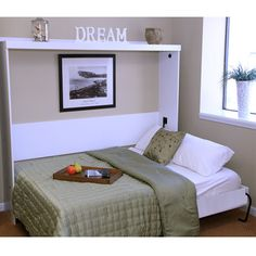 Horizontal Murphy bed. I'd love to do this for our room. It's long and narrow, so we'd benefit from this design.