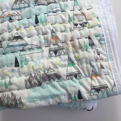Truly one of a kind hand stitched kantha baby quilt. Tee Pee premium cotton fabric with mint green, aqua, orange, black, lime, and white. Hand
