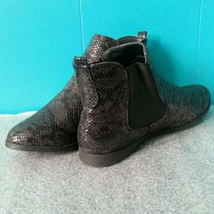 NWOT Diva Lounge Faux Snakeskin Black Booties-2XHP **H P**01/02***01/08 Faux snakeskin pattern adds character to this basic black bootie. Elastic on both sides aid in easy on/off. Light and comfy with traction. All man-made materials.  NWOT and also no box. Will place in a shoebox if requested;) Diva Lounge Shoes Ankle Boots & Booties