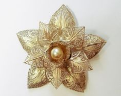 This is a beautiful vintage sterling silver brooch by Topazio!  This brooch is ornately filigreed and features a 7 mm faux pearl in the center. It is Hallmarked Topazio Portugal 0.925.  This brooch was crafted in Portugal.