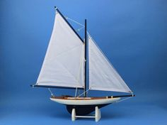 NOT A MODEL SHIP KITÿ ÿ Attach Sails and this Sailboat Centerpiece is Ready for Immediate Displayÿ ÿ Brighten your day, or any room of your home, with this delightfully fun America's Cup Contender mod