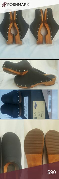 NEW Sanita YANNI Low Flex Real Wood Leather Clogs Brand new in box without original tags. NEVER WORE Sanita Real Wood & Real Yak Leather Original Danish Clogs  Color: Black  Size 39 EU/8.5-9 US  Accented w/ Silvertone studs Purchased 3/5/2016 for $120!!!  Medium width  Soft YAK Leather  ANY AREAS YOU SEE ON THE WOOD OR THE BOTTOM ARE NOT DUE TO WEAR. THESE ARE REAL WOOD & AREAS WERE PRODUCED DURING THE MAKING/MANUFACTURING PROCESS ONLY!! Sanita  Shoes Mules & Clogs