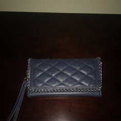 NWT'S  Spacious navy clutch w/silver chain detail NWT'S  Spacious faux leather navy clutch/ wrislet w/silver chain detail. Paisley print interior design with multiple compartments. One large compartment has a zipper closure., Kelly & Katie Bags Clutches & Wristlets