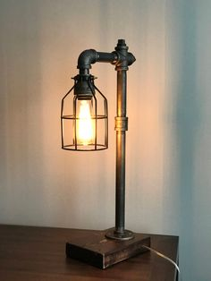 Industrial Lighting - Steampunk Lamp - Table Lamp - Edison Light - Vintage Light - Pipe Lamp - Bedside Lamp - Rustic Lighting - Bulb Cage by ThePipeStudio on Etsy https://www.etsy.com/listing/515939442/industrial-lighting-steampunk-lamp-table