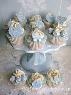 Beautiful cupcakes for a baby boy celebration.