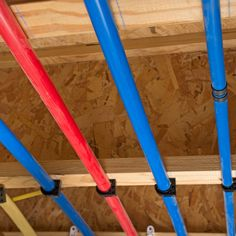 PEX piping is the biggest revolution since the flush toilet. Learn what it is and everything in between with this PEX plumbing guide. Plumbing Pipe Shelves, Pex Plumbing, Bathroom Plumbing, Basement Bathroom, Plumbing Drains, Bathroom Fixtures, Pipe Table, Pipe Desk, Working Wall