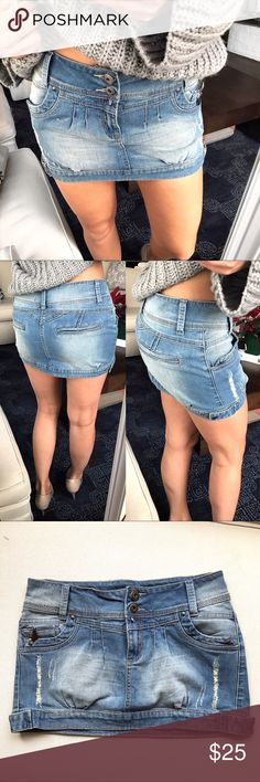 Denim Mini Skirt 💙 Like brand new. Measure approximately 10.75 inches in front in the middle, 14 inches in the back in the middle and 15.5 inches waste laying flat. 98% cotton, 2% Elastane. Aye size 10 but not true, best for 4. Miso Skirts
