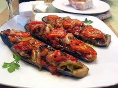 "Imam Baildi are stuffed eggplants. This is a vegetarian dish and it falls into the category of Greek cooking called ""ladera"" or lathera. Ladera dishes were born out of necessity, peasan… Gourmet Recipes, New Recipes, Vegetarian Recipes, Cooking Recipes, Favorite Recipes, Vegetarian Dish, Bulgarian Recipes, Turkish Recipes, Greek Recipes"