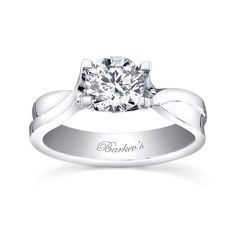 Strong and bold with a contemporary styling this cathedral solitaire engagement ring sports prongs that rise from the shank to hold the round diamond center securely in it's grasp.  The bright polished mirror like finish adds a touch of glamour. <br />  <br />  Also available in yellow gold, 18k and Platinum.