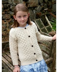 Keep the little ones warm this winter with this Childs Irish Aran Cardigan. This Natural Wool Cardigan looks adorable and features beautiful Irish Aran patterns that make this cardi Merino Wool Sweater, Wool Cardigan, Wool Sweaters, Irish Sweaters, Pink Cardigan, Sweater Shop, Men Sweater, Irish Clothing, Irish Fashion