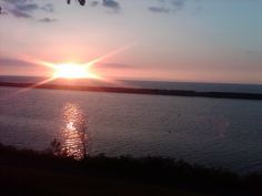 Sun setting over Lake Ontario as seen from Breitbeck Park, Oswego, NY