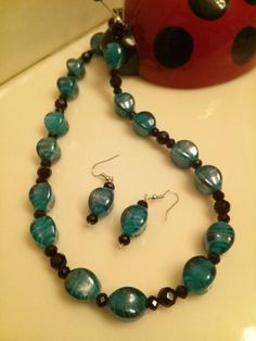 teal glass beads with black crystals