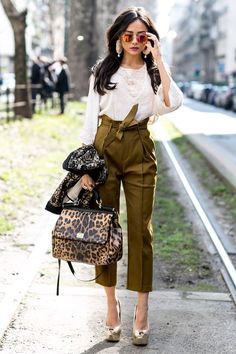 Must-See Street Style From Milan Fashion Week Fall 2015 - high-waisted cropped olive green pants with waist tie worn with an embroidered knit top + gold platform heels, sunglasses, and a leopard bag