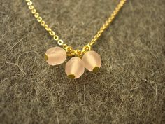 Pink beads on gold necklace