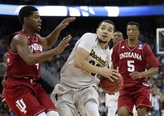 Wichita State guard Fred VanVleet, center, drives to the basket between Indiana's Robert Johnson, left, and Troy Williams (5) during the second half of WSU's 81-76 NCAA Tournament victory in March.