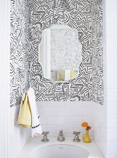 Designer Crush: Alexandra Loew // white tile wall, black and white wallpaper, yellow vase