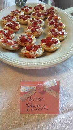 Cute as a button, party food. These are bagel bite pizzas with tiny pepperoni I placed on top 1/2 way during cooking process....to look like buttons of course